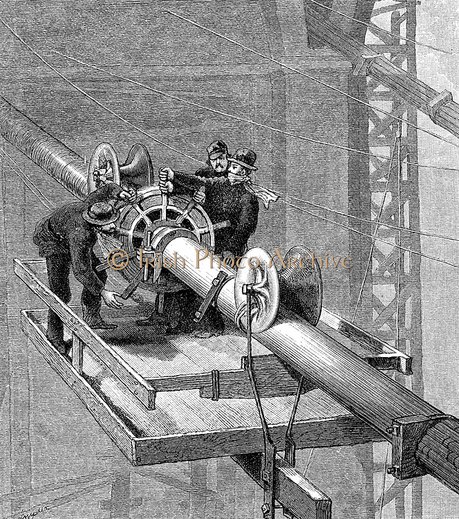 Brooklyn Suspension Bridge, New York: Putting wire wrapping around the suspension cables, each of which was made up of more than 5,000 separate strands.   Wood engraving published 1883, the year the bridge opened. Designed and built by JA Roebling and his son WA Roebling.