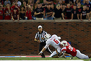 DALLAS, TX - AUGUST 30: Baker Mayfield #6 of the Texas Tech Red Raiders is tackled by Robert Seals #30 the SMU Mustangs on August 30, 2013 at Gerald J. Ford Stadium in Dallas, Texas.  (Photo by Cooper Neill/Getty Images) *** Local Caption *** Baker Mayfield; Robert Seals