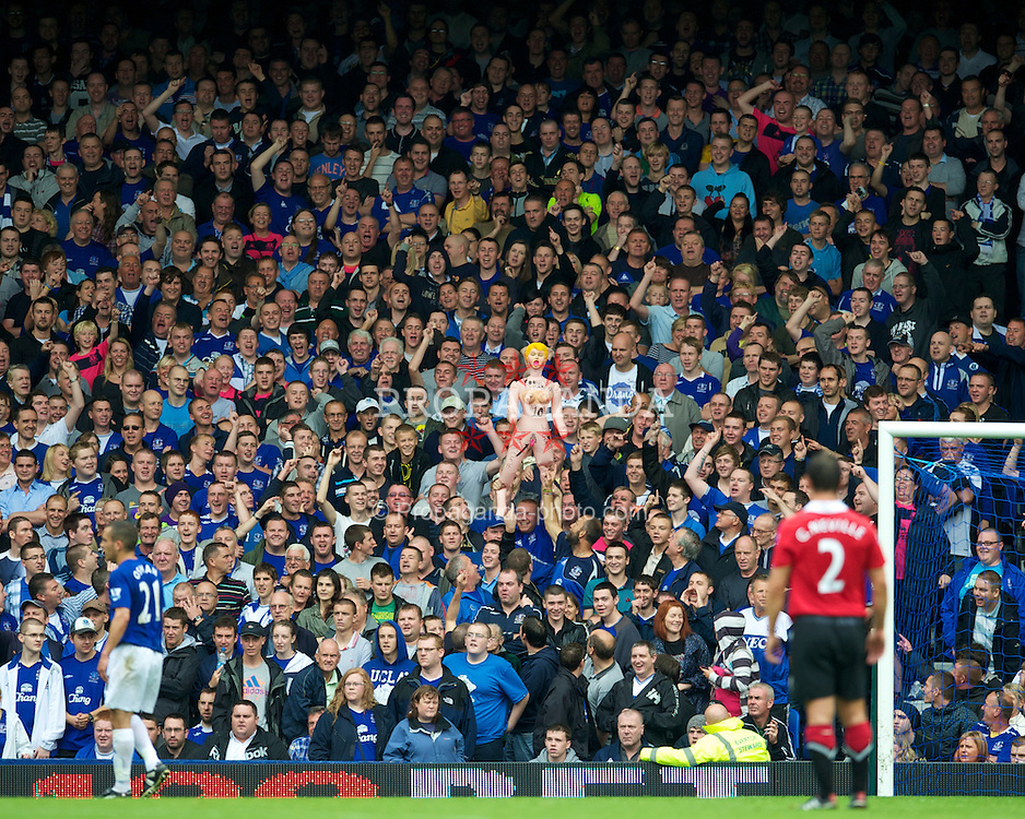 LIVERPOOL, ENGLAND - Saturday, September 11, 2010: Everton's supporters taunt Manchester United's Wayne Rooney with an inflatable sex doll during the Premiership match at Goodison Park. (Photo by David Rawcliffe/Propaganda)
