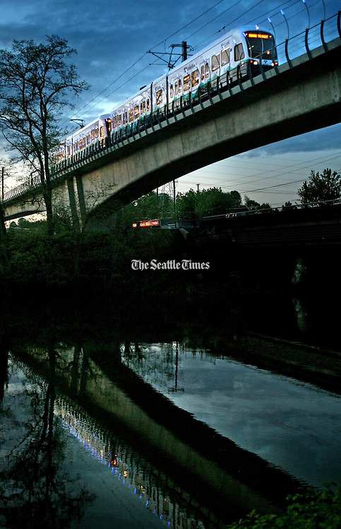 A Sound Transit light-rail train heads over the Duwamish River in Tukwila.<br /> <br /> Ellen Banner / The Seattle Times