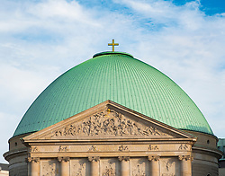 View of green dome of St Hedwigs Cathedral in Mitte, Germany.