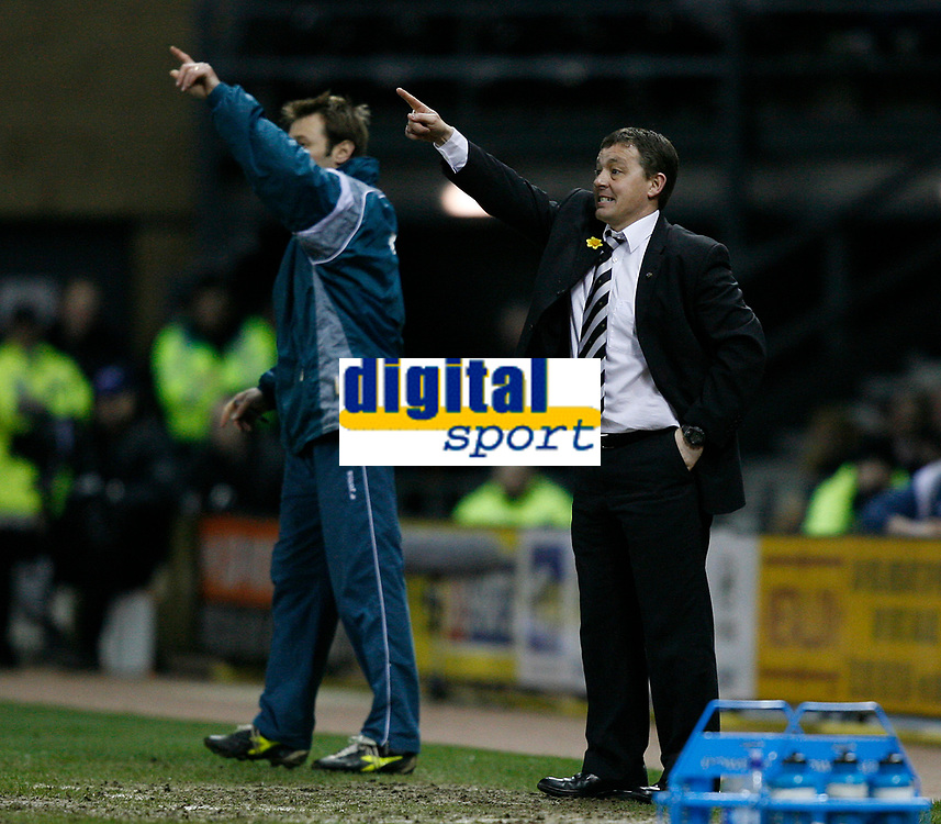 Derby manager Billy Davis issues instructions from the touchline
