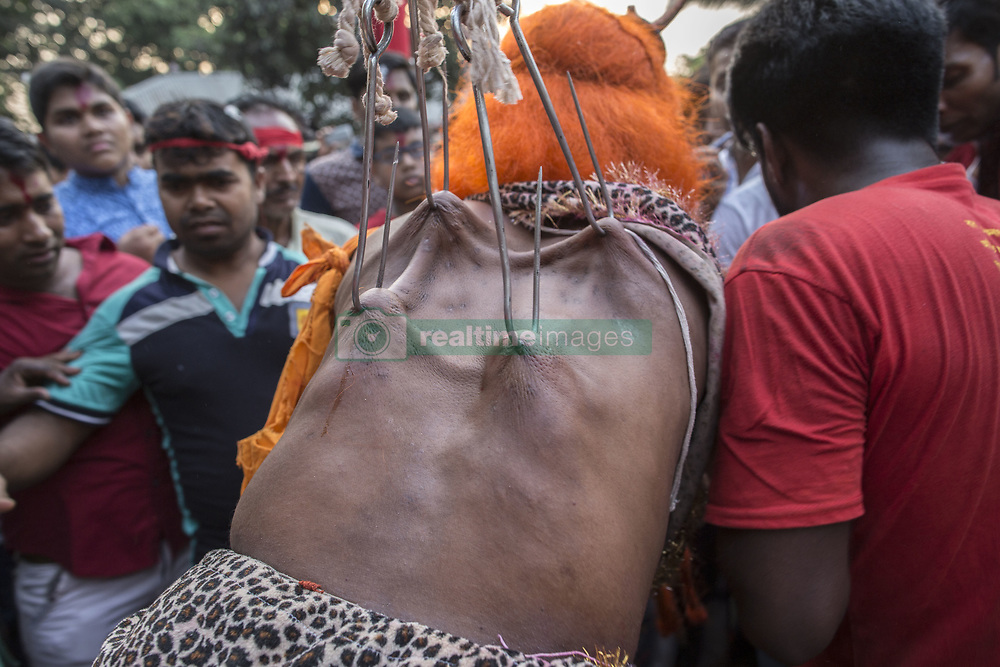 April 14, 2017 - Gazipur, Dhaka, Bangladesh - A group of Hindu devotees perform the rituals of Charak Puja, a very enchanting folk festival of Southern Belt of Bangladesh and West Bengal. Also known as Nil Puja, Hindus believe that the festival will carry prosperity by eliminating the sorrow and sufferings of the previous year. The festival is actually a festival to satisfy Lord Shiva. (Credit Image: © Probal Rashid via ZUMA Wire)