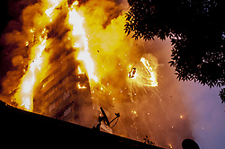 June 14, 2017 - London, UK - Falling burning debris at the scene of a huge fire at Grenfell tower block in White City, London. The blaze engulfed the 27-story building with 200 firefighters attending the scene. At least six people have died in the blaze. (Credit Image: © Guilhem Baker/London News Pictures via ZUMA Wire)