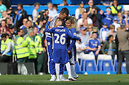 John Terry, the Chelsea captain hugs his children during a walk around the pitch after full time. Barclays Premier league match, Chelsea v Leicester city at Stamford Bridge in London on Sunday 15th May 2016.<br /> pic by John Patrick Fletcher, Andrew Orchard sports photography.