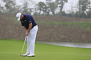 Shane Lowry (IRL) putts on the 17th green during Saturay's Round 3 of the 2014 BMW Masters held at Lake Malaren, Shanghai, China. 1st November 2014.<br /> Picture: Eoin Clarke www.golffile.ie