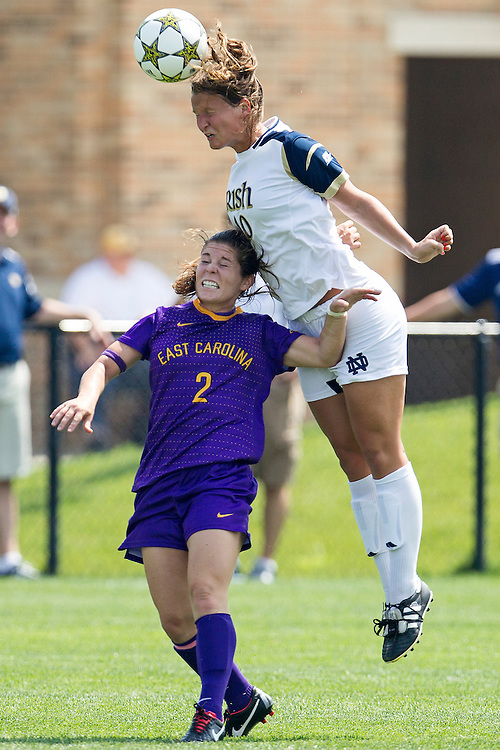 August 26, 2012:  Notre Dame midfielder Glory Williams (#10) and East Carolina defender Rachel Fuller (2) go up for the ball during NCAA Soccer match between the Notre Dame Fighting Irish and the East Carolina Pirates at Alumni Stadium in South Bend, Indiana.  Notre Dame defeated East Carolina 5-0.