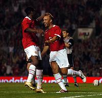 Mikael Silvestre celebrates scoring 1st goal with Louis Saha<br />Manchester United 2004/05<br />Manchester United v PSV Eindhoven<br />The Vodafone Cup 03/08/04<br />Photo Robin Parker Fotosports International