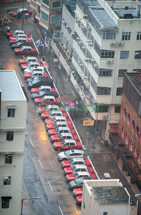 August 23, 2017 - Hong Kong, Hong Kong SAR, China - No taxis working today. Hong Kong iconic red taxis remain parked up in Tin has as Typhoon Hato hits land in Hong Kong causing a T10 status Severe Typhoon rating. .© Jayne Russell. 23rd August 2017. (Credit Image: © Jayne Russell via ZUMA Wire)