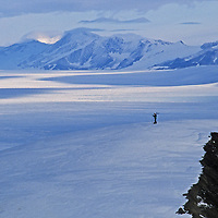 A lone ski mountaineer stands atop the Patriot Hills in the southern Ellsworth Mountains, Antarctica.