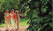 Three women enjoy an afternoon together at a botanical garden