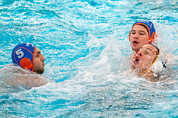 Guus Wolswinkel, Guus van IJperen of the Netherlands in action against MiroslavPerkovic of Montenegro during the Olympic qualifying tournament. The Dutch water polo players are on the hunt for a starting ticket for the Olympic Games on February 19, 2021 in Rotterdam