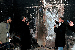 © under license to London News Pictures. 24/02/2011. Opposition members try to break through a door which was welded shut in an underground prison at the Army Compound in Benghazi, Libya. Photo credit should read Michael Graae/London News Pictures