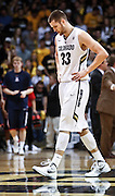 SHOT 1/21/12 5:38:01 PM - Colorado's Austin Dufault #33 walks off court with his head down against Arizona during their PAC 12 regular season men's basketball game at the Coors Events Center in Boulder, Co. Colorado won the game 64-63..(Photo by Marc Piscotty / © 2012)