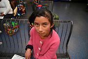 An 11-year-old Guatemalan girl waits with her mother in Tucson at bus station where she was dropped off by the U.S. Border Patrol after being apprehended near Douglas, Arizona, USA, where they crossed the border illegally from Mexico.  The two traveled for about five days from Guatemala to get to the Arizona border.  They, along with others, heard in Guatemala that mothers with children could find work in the U.S. and better their lives.  Recently flooded with undocumented migrants from Central America, federal authorities are transporting children with adults to bus stations where they will head to other states in the U.S.  Their status in the U.S. will be addressed by authorities after they reach their destination.
