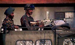 July 1997. Srinagar, Kashmir, India..Indian soldiers patrol the restive Kashmiri region. The Indian government struggles to contain the rising insurgency amidst fears of a civil war in the region..Photo; Charlie Varley