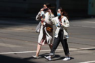 Two woman are seen crossing the road in the CBD during COVID-19 in Melbourne, Australia. Premier Daniel Andrews announced today that some minor changes will be made to the current Stage 4 Restrictions in Melbourne. As yet, there is no sign of any meaningful change despite numbers of new cases being under 5 for the 14 day rolling average. Zero cases and no deaths were recorded in the past 24 hours in Victoria. (Photo by Dave Hewison/Speed Media)