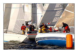 Yachting- The start of the Bell Lawrie Scottish series 2002 at Gourock racing overnight to Tarbert Loch Fyne where racing continues over the weekend.<br /><br />Enigma Sigma 36 GBR3926, Troy Mistral 31 GBR5318 class 4 and Blyth Spirit X332 GBR6917T Class 3 fight for a space at the line.<br /><br />Pics Marc Turner / PFM