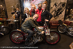 Danilo Seclì seated on the Radikal Choppers first place winner (in the EICMA Custom Show) with Marie-Line Thioulouze, Andrea Radaelli (from Radikal), Giuseppe Roncen and Sara Jukic during EICMA, the largest international motorcycle exhibition in the world. Milan, Italy. November 21, 2015.  Photography ©2015 Michael Lichter.