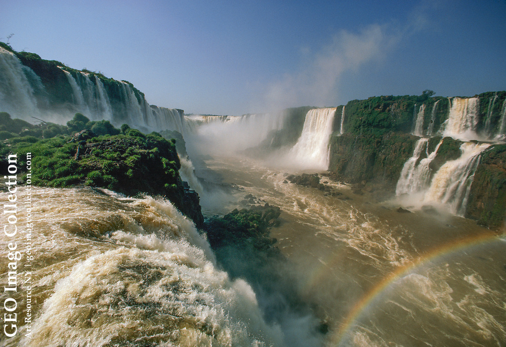 Iguacu Falls as seen from the Brazilian observation deck.  Iguacu Falls stretch es for two miles near the borders of Argentina, Paraguay, and Brazil.