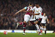Dimitri Payet of West Ham United back heels the ball. The Emirates FA cup, 6th round replay match, West Ham Utd v Manchester Utd at the Boleyn Ground, Upton Park  in London on Wednesday 13th April 2016.<br /> pic by John Patrick Fletcher, Andrew Orchard sports photography.