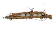 Duck eggs wrapped in rice straw, Lao Meng village market, Yunnan province, China