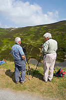 Bird watchers in the forest of Bowland looking at Eagle Owls