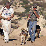Armed citizens patrol along the U.S.-Mexico border in San Diego, California in hopes of stopping the undocumented migrants from crossing their property into the United States. Please contact Todd Bigelow directly with your licensing requests.
