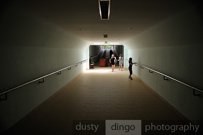 Children walking through the newly built formal tunnel entrance to the Cu Chi Tunnel Memorial. Cu Chi, Vietnam