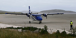 Barra Airport is a short-runway airport situated in the wide shallow bay of Traigh Mhòr at the north tip of the island of Barra in the Outer Hebrides, Scotland. Barra is now the only beach airport anywhere in the world to be used for scheduled airline services. Loganair Twin Otter starting engines. (c) Stephen Lawson   Edinburgh Elite media