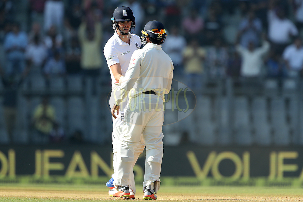 James Anderson of England shakes hands with Parthiv Patel of India  after the match during day 5 of the fourth test match between India and England held at the Wankhede Stadium, Mumbai on the 12th December 2016.<br /> <br /> Photo by: Ron Gaunt/ BCCI/ SPORTZPICS