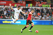 Swansea city's Gylfi Sigurdsson (l) chases Morgan Schneiderlin of Man Utd. Barclays Premier League match, Swansea city v Manchester Utd at the Liberty Stadium in Swansea, South Wales on Sunday 30th August  2015.<br /> pic by Andrew Orchard, Andrew Orchard sports photography.
