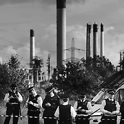 Police guarding the oil refinery making sure no activists get any closer. The road in and out of the refinery is now blocked by 12 women formin a human blockade by being locked on under two vehecles on the road. ..Crude Oil Awakening is a coalition of climate change activist groups. On Saturday Oct 16 they shut the only entrance to Coryton oil refinery in Essex, UK with the aim of highlighting the issues of climate change and the burning of fossil fuels. The blockade meant that a great number of trucks with oil were not able to leave the refinary during the day of action.