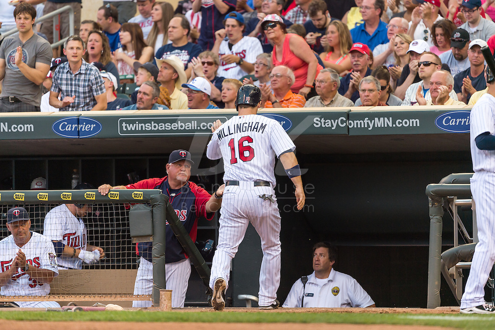 Josh Willingham #16 of the Minnesota Twins is congratulated by manager Ron Gardenhire #35 after scoring against the Kansas City Royals on June 27, 2013 at Target Field in Minneapolis, Minnesota.  The Twins defeated the Royals 3 to 1.  Photo by Ben Krause