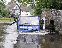 © Licensed to London News Pictures. 11/06/2012. Kent. UK. The River Darent in Eynford on flood alert today 11/06.2012. A truck driving in the ford at Eynsford as water levels rise. Photo credit : Grant Falvey/LNP