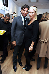 GEORGE VERONI and his wife TAMARA BECKWITH at a private view of 'Most Wanted' an exhibition of photographs held at The Little Black Gallery, Park Walk, London on 27th November 2008.