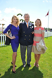 Left to right, CHRISTIE BRINKLEY and ARNAUD & CARLA BAMBERGER at the 27th annual Cartier International Polo Day featuring the 100th Coronation Cup between England and Brazil held at Guards Polo Club, Windsor Great Park, Berkshire on 24th July 2011.