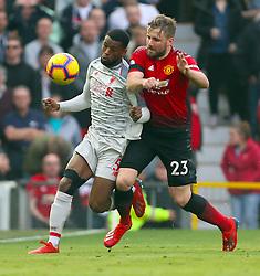 Liverpool's Georginio Wijnaldum (left) and Manchester United's Luke Shaw battle for the ball