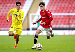 Manchester United's Alejandro Garnacho (right) and Villarreal's Aitor Gelardo battle for the ball during the UEFA Youth League, Group F match at Leigh Sports Village, Manchester. Picture date: Wednesday September 29, 2021.