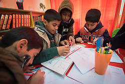 19 February 2020, Amman, Jordan: A group of boys make use of a room called 'Spaces for Creativity' at the Al Areen Secondary School for Boys in the Al Jeeza district. The room has emerged through a project by the Lutheran World Federation, whereby the school buildings and classrooms have been refurbished, and a school initiative has introduced 'Spaces for Creativity' as a way of nurturing students' creative and thinking skills. This type of learning environment is otherwise rare in Jordanian public shools. The Al Areen Secondary school teaches boys from 4th - 12th grade, most of them Jordanian, but a few also of other nationalities.