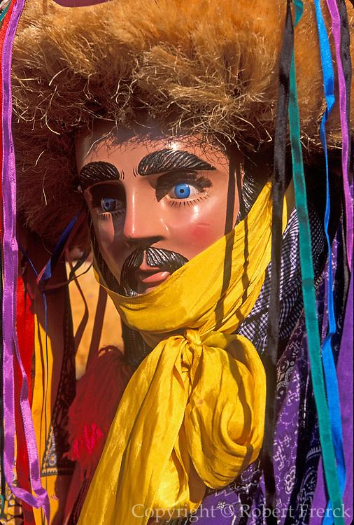 MEXICO, FESTIVALS, CHIAPAS Fiesta de Enero in Chiapa de Corso; men and boys as 'Parachicos' dance in streets with headdresses of ixtle fibre