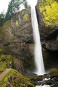 Liana Welty stands besides dramatic Latourell Falls in Oregon's waterfall-ridden Columbia Gorge.