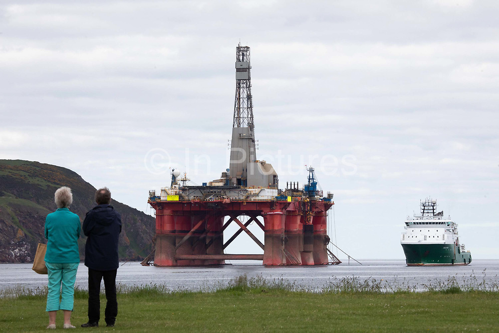 Greenpeace activists board a BP oil rig in Cromarty Firth to stop it from further oil drilling at sea, June 10th 2019, Cromarty, Scotland, United Kingdom. The oil rig Paul B. Loyd, Jnr, owned by Transocean, was due to head to BPs Vorlich field, 150 miles 241km east of Aberdeen to drill for oil for BP. Onlookers watch the occupied oil rig.The occupation by Greenpeace activists subsequently delayed the departure for 5 days and 14 activists were arrested in the process. Greenpeace says that in an age of climate emergency BP should not be drilling for new oil but look for non-fossil fuel means of energy.