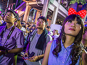 31 DECEMBER 2012 - BANGKOK, THAILAND: Thais wait for the New Year just before midnight on New Year's Eve at the party and countdown in Ratchaprason intersection in Bangkok. The traditional Thai New Year is based on the lunar calender and is celebrated in April, but the Gregorian New Year is celebrated throughout the Kingdom, especially in larger cities and tourist centers, like Bangkok, Chiang Mai and Phuket. The Bangkok Countdown 2013 event was called ?Happiness is all Around @ Ratchaprasong.? All of the streets leading to Ratchaprasong Intersection were closed and the malls in the area stayed open throughout the evening.    PHOTO BY JACK KURTZ