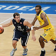 Anadolu Efes's Kerem TUNCERI (L) and Maccabi Tel Aviv's Keith LANGFORD (R) during their Turkish Airlines Euroleague Basketball Group C Game 4 match Anadolu Efes between Maccabi Tel Aviv at Sinan Erdem Arena in Istanbul, Turkey, Thursday, November 10, 2011. Photo by TURKPIX