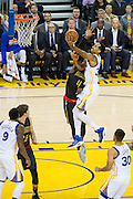 Golden State Warriors guard Shaun Livingston (34) drives to the basket against Atlanta Hawks forward Paul Millsap (4) at Oracle Arena in Oakland, Calif., on November 28, 2016. (Stan Olszewski/Special to S.F. Examiner)