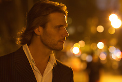 handsome man with long hair out on the town in New York City