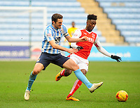 Coventry City's Sam Ricketts vies for possession with Fleetwood Town's Devante Cole<br /> <br /> Photographer Andrew Vaughan/CameraSport<br /> <br /> Football - The Football League Sky Bet League One - Coventry City v Fleetwood Town - Saturday 27th February 2016 - Ricoh Stadium - Coventry   <br /> <br /> © CameraSport - 43 Linden Ave. Countesthorpe. Leicester. England. LE8 5PG - Tel: +44 (0) 116 277 4147 - admin@camerasport.com - www.camerasport.com