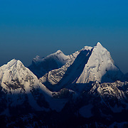 The stunning pyramid of Jobo Rinjang, aka Lunag Ri, rises from the shadows of the Himalaya at sunrise, as seen from 23,000 feet on the West Ridge Headwall, Mount Everest, Nepal.