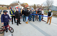 Laconia Parks and Recreation directior Amy Lovisek and Mayor Andrew Hosmer joined by city officials and dozens of skate boarders and riders for the official ribbon cutting at the Laconia Skate Park Friday afternoon.    (Karen Bobotas Photo/for The Laconia Daily Sun)